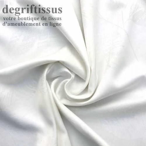 Dégriftissus vous propose ce tissu d'ameublement double face satiné blanc à fleurs striées Vous allez pouvoir agrémenter votre