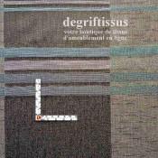 Dégriftissus vous propose ce superbe tissage Jacquard, à larges bandes noires et grises chinées, avec rayures brillantes bleues