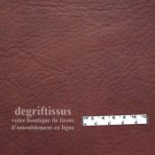 Dégriftissus vous propose ce tissu d'ameublement cuir pleine fleur accajou nuagé haut de gamme doublé d'une fine mousse au milie