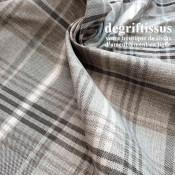 Dégriftissus vous propose ce tissu d'ameublement écossais madras gris beige, tissé Jacquard de très haute qualité doublé latex,